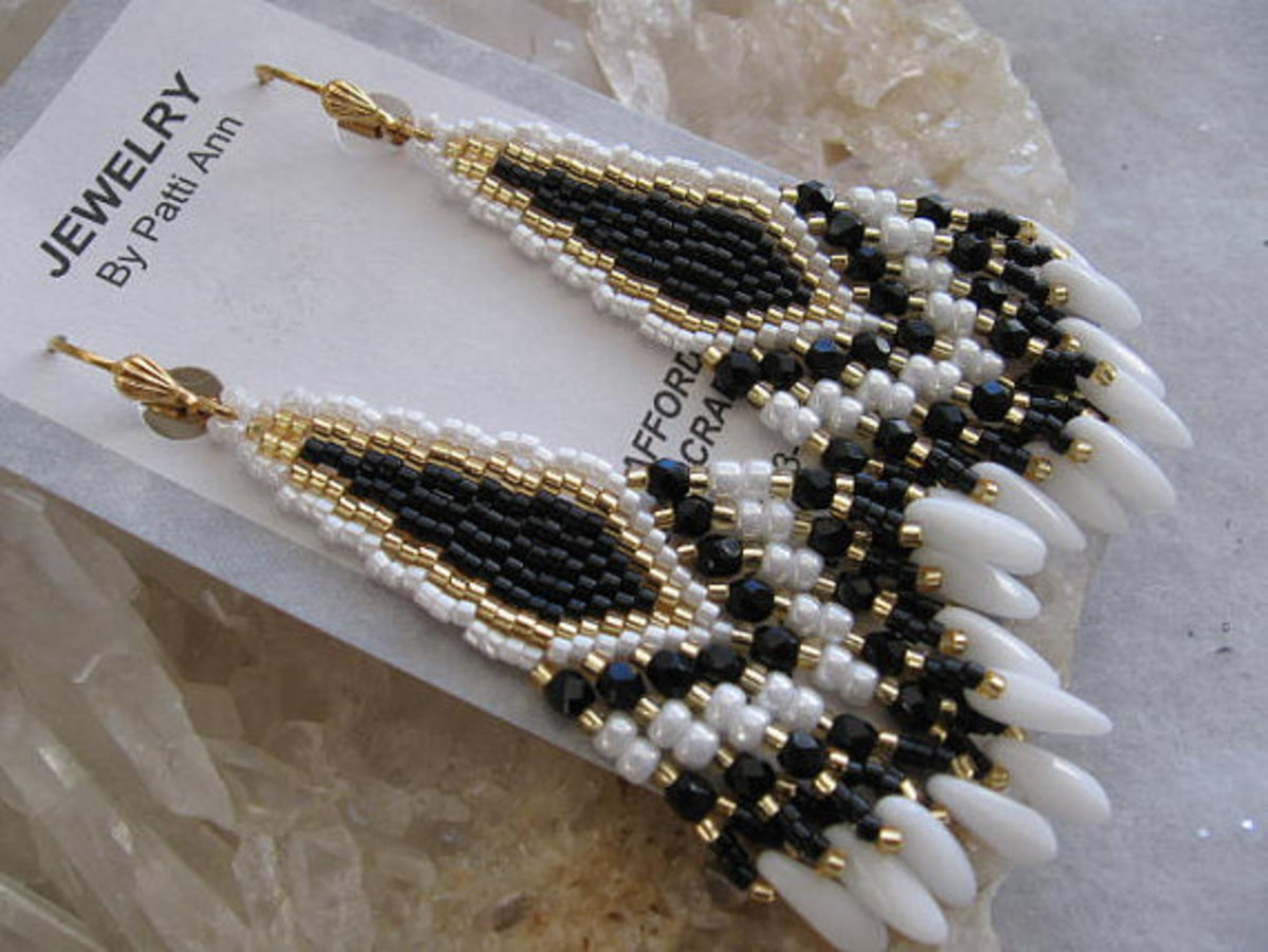 I love this kind of beadwork with fringe for earrings.  You can adjust the size of the piece to accommodate larger daggers.