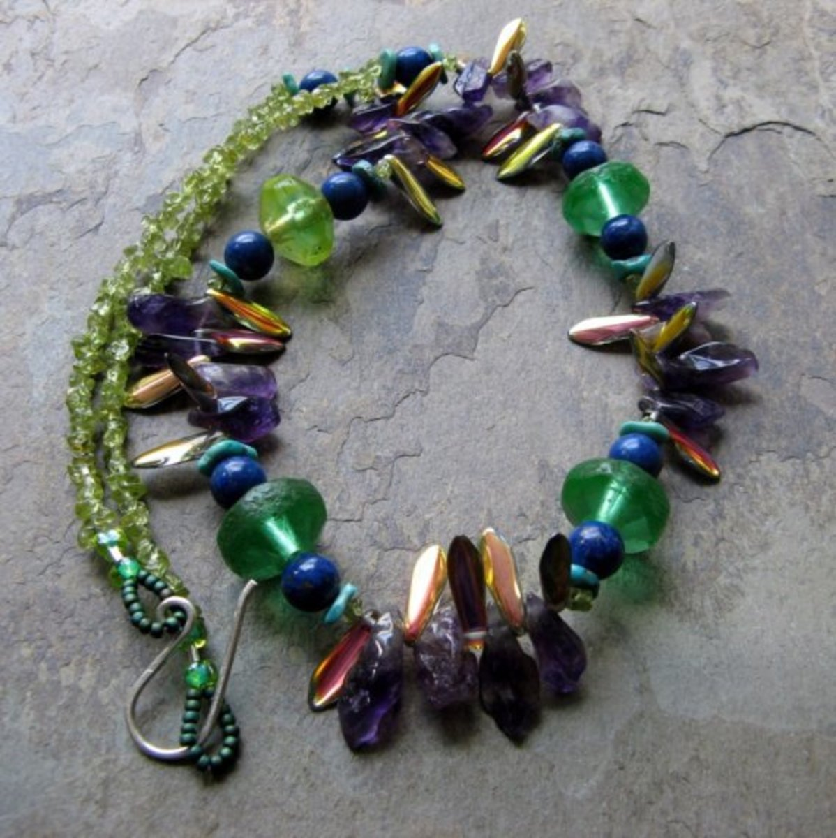 Consider mixing daggers with all sorts of other jewelry components such as gemstones or gemstone chips like Sarah does.