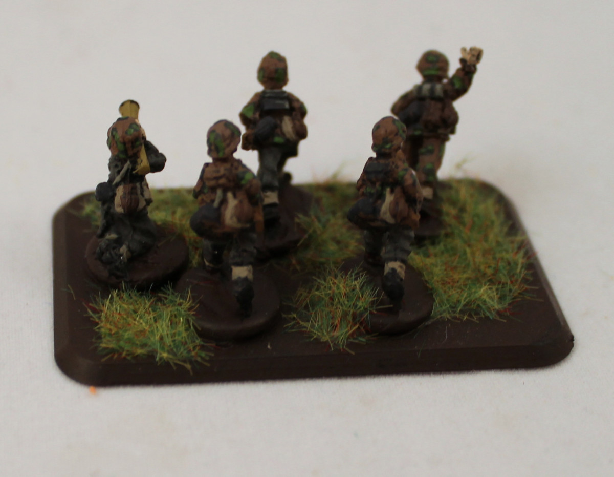 Camouflage is a nice touch, but are you ready to paint it on a figure that's just 15mm tall?