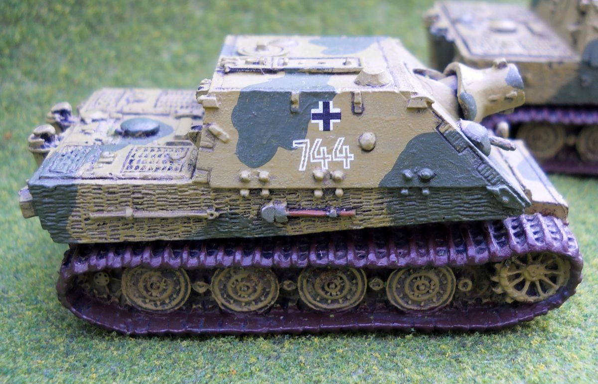 This Sturmtiger has decals, rusty tracks, and painted shovel.