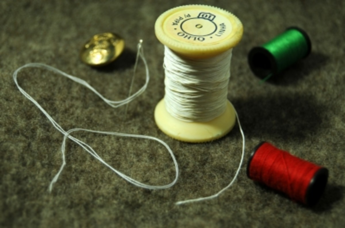 Don't forget to remove the stickers from the ends of your spools, it makes it easier to pass the cord through the spool.