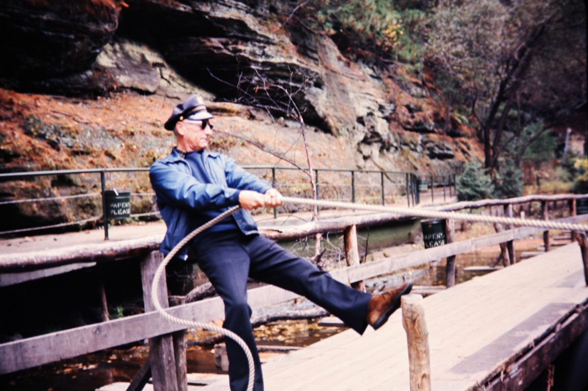Old photo of our boat captain securing our landing for one shore excursion at the Wisconsin Dells.