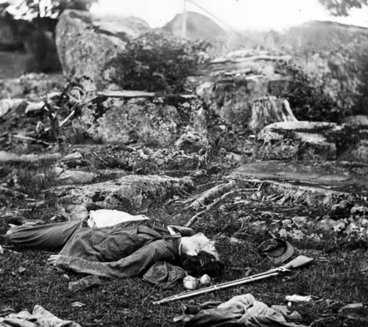 Dead Confederate soldiers in the Devil's Den at Gettysburg