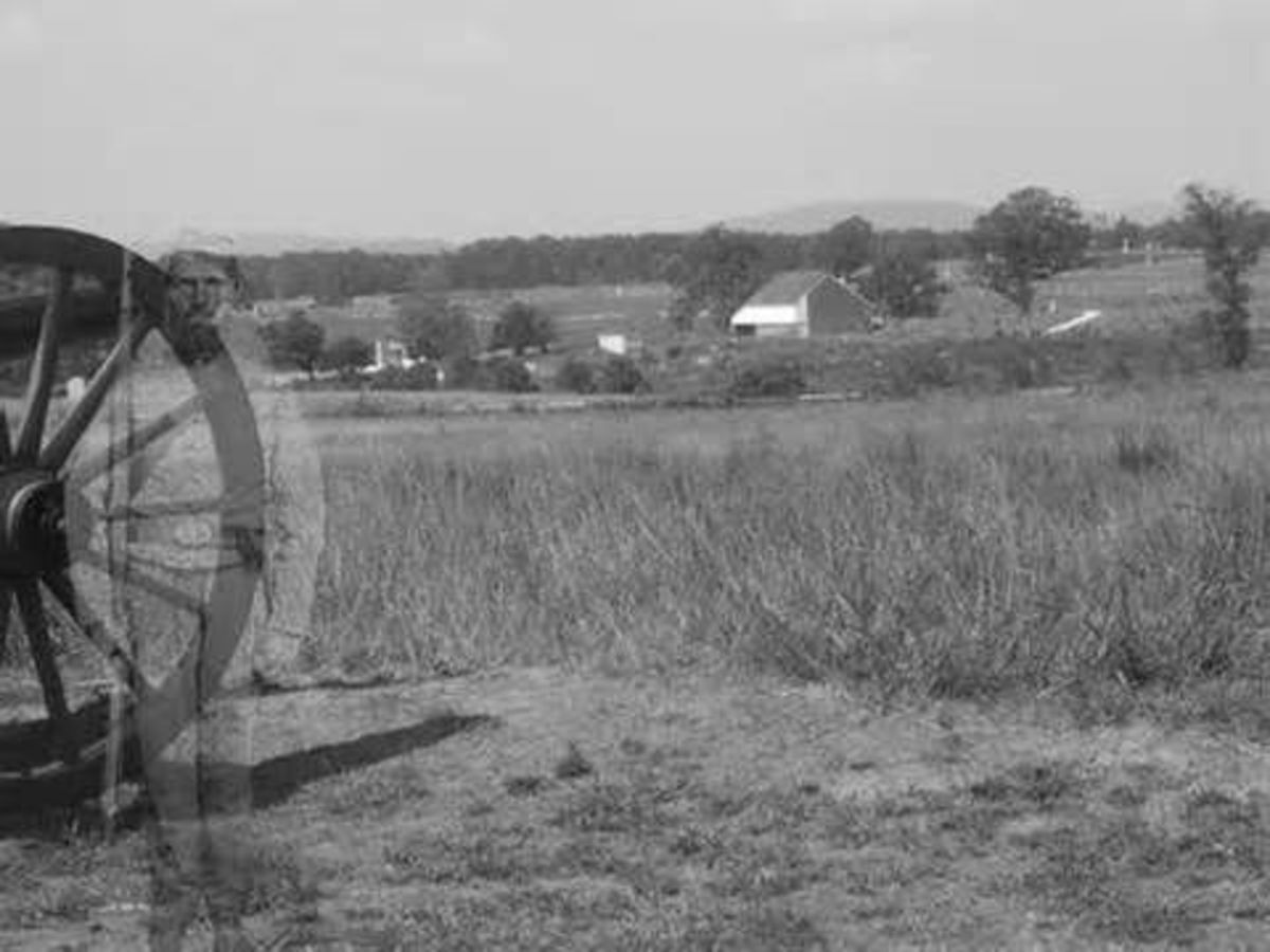 Really Great Gettysburg Ghost Photo. Look on left hand side of photo. The soldier is there plain as day.