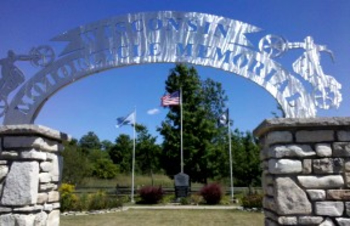 "Shining arch over the entryway says ""Wisconsin Motorcycle Memorial"""
