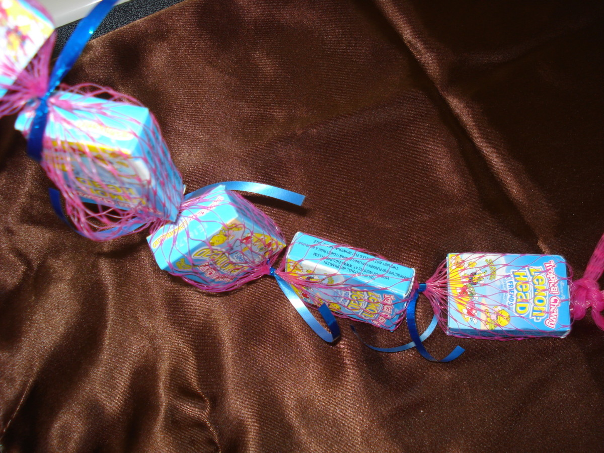 Continue to tie ribbons between each candy.
