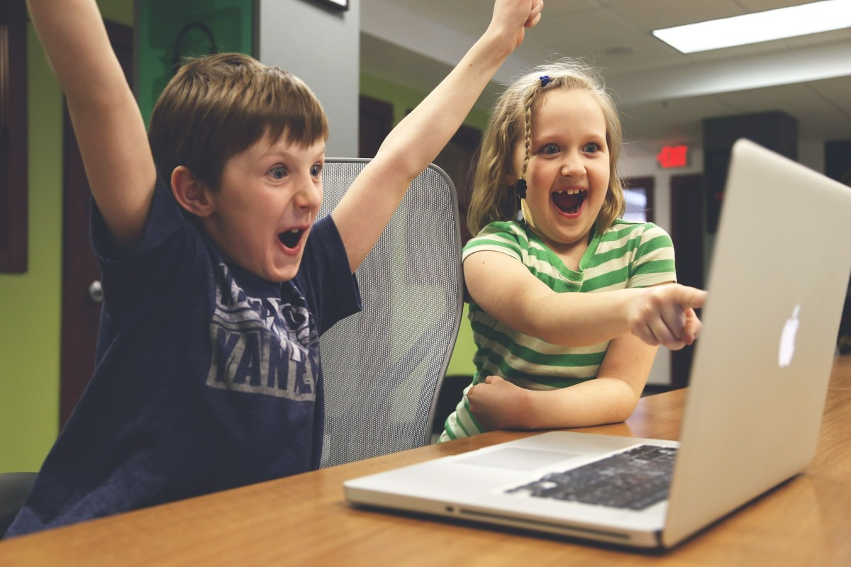 These children are having fun at their computer, but hopelfully they enjoy Mom or Dad reading to them.
