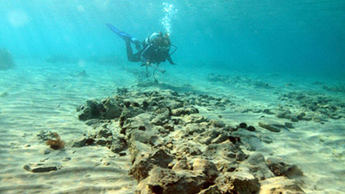 A diver exploring Pavlopetri, off the coast of Greece