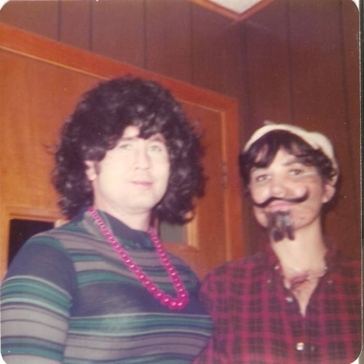 Cross-dressers for Halloween. My dad is on the left and my mom is on the right. (Obviously.) 1976