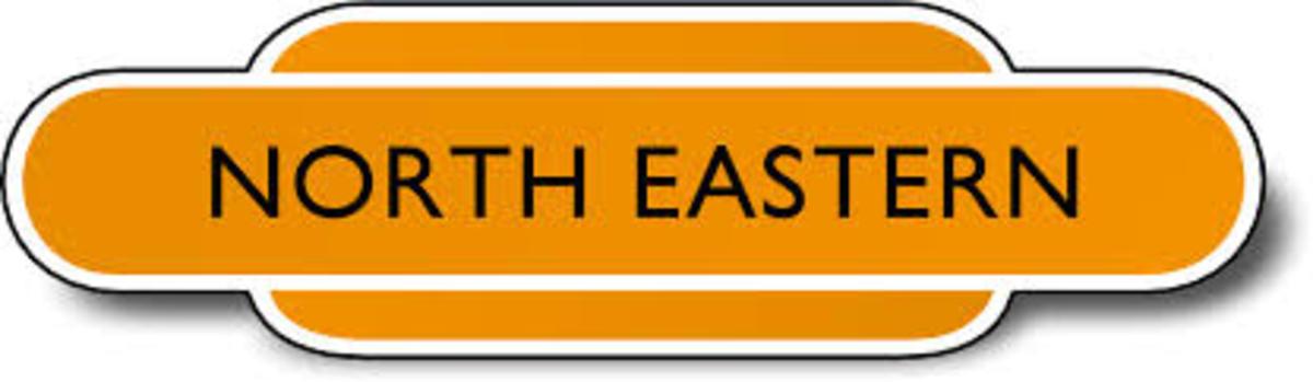 British Railways' North Eastern Region totem, black lettering, tangerine body with white trim and black edging