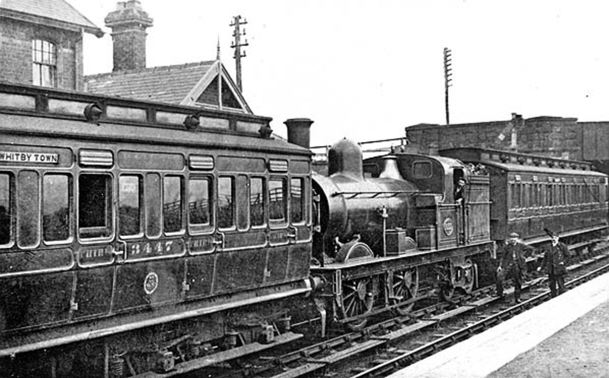 An interesting formation, further back in time, at Hinderwell on the coast north of Whitby here's a Fletcher Bogie Tank Passenger locomotive between two 'porthole' ended brake clerestory carriages - driver and fireman only met at termini or shift end