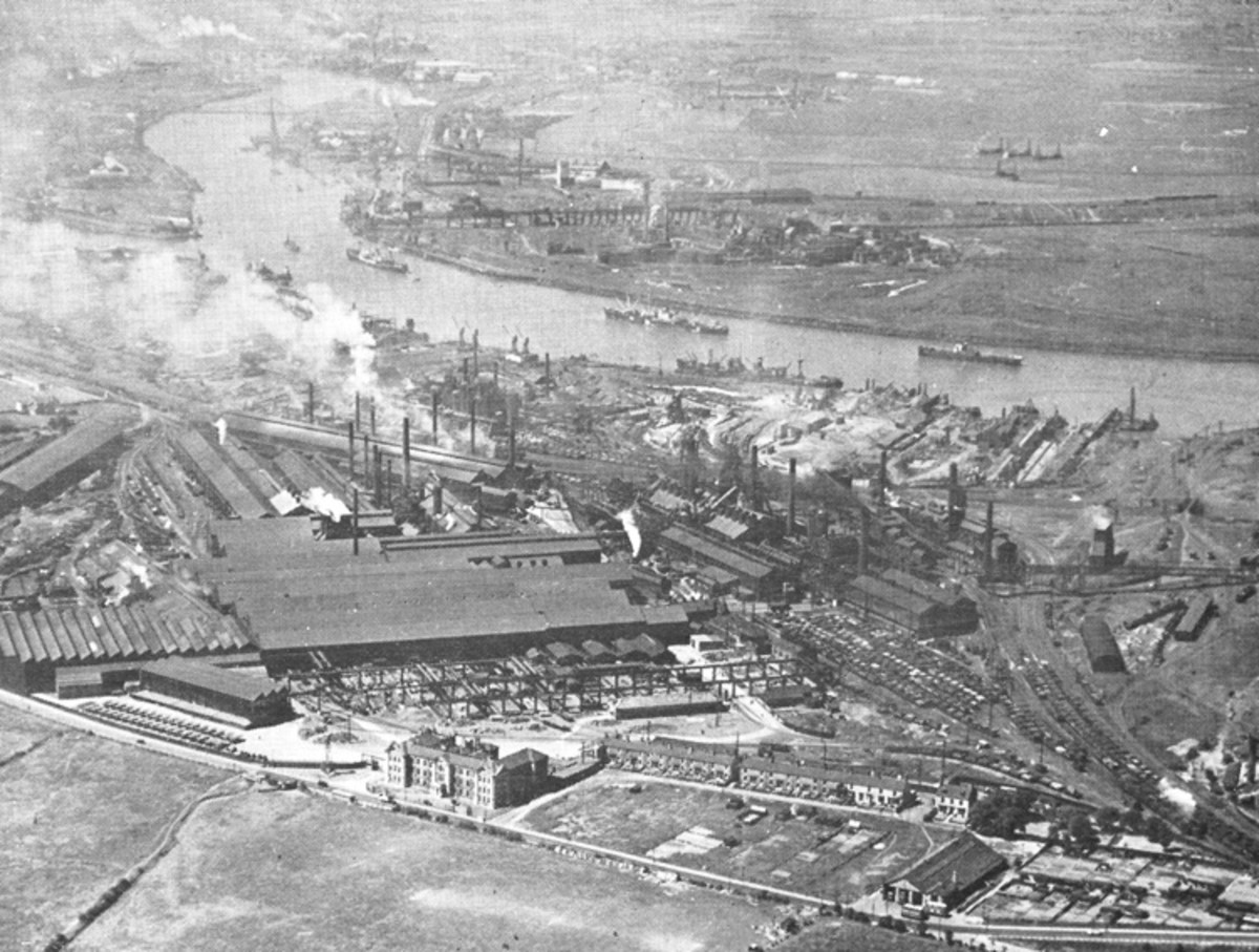 Cargo Fleet Steel Works lay near the river, with the Saltburn railway between. Facing the road (Middlesbrough-South Bank) is the large office building. To the left was the huge gateway that sported a gigantic suit of armour made in the works