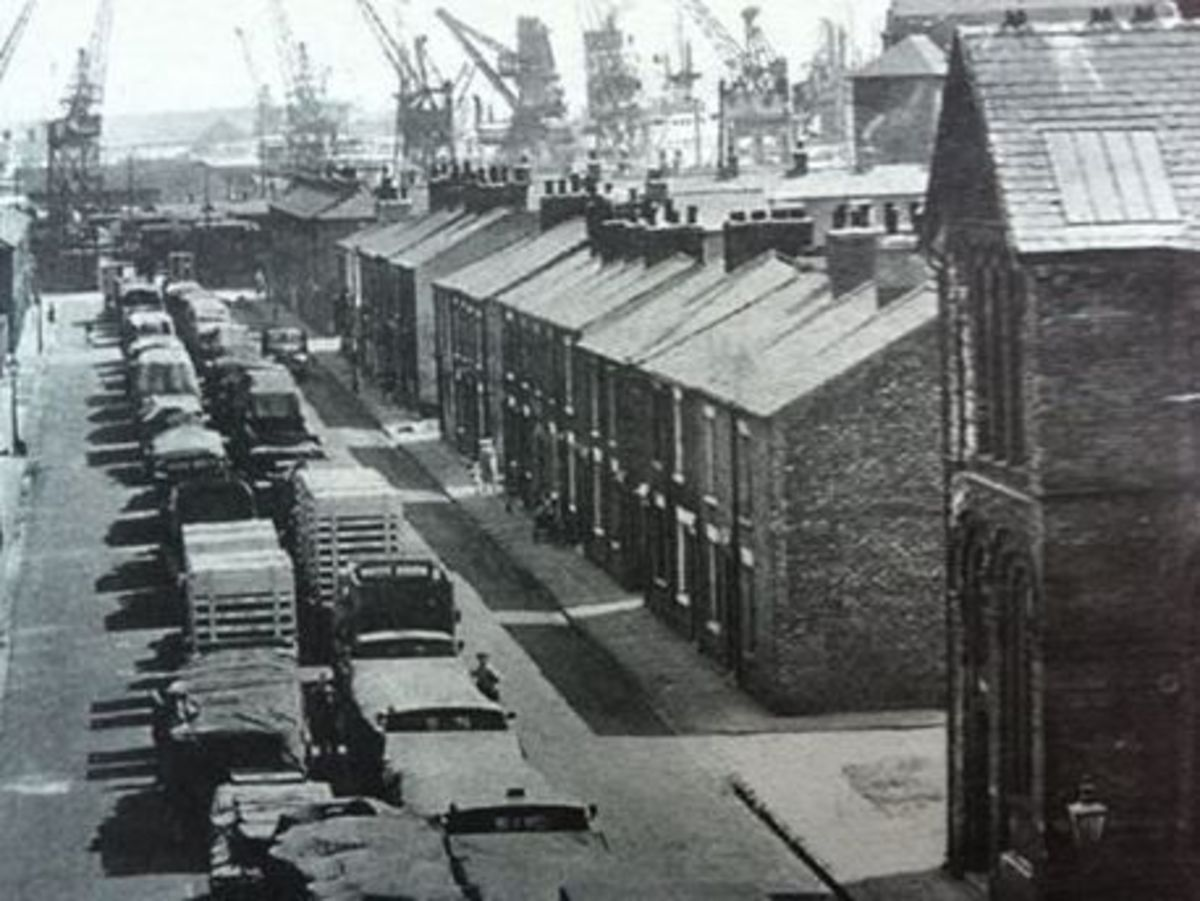 The view in the 1950s along Lower East Street, Middlesbrough towards the docks on the Tees. Within decades the docks were cleared and re-located near Teesmouth. Most dockyard workers' jobs disappeared through mechanisation
