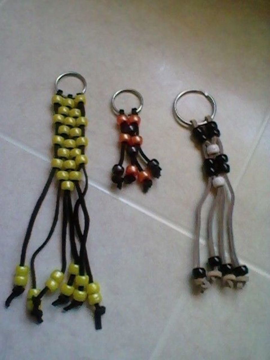 Key Chains In Different Lengths With Different Size Key Rings.  Also Different Color Leather Lacing.