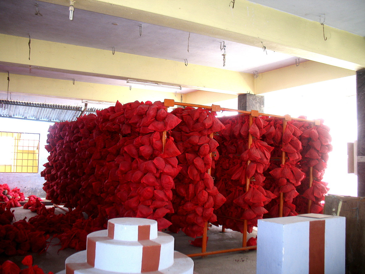 Bags of Saffron with Coconuts kept inside the temple of those devotees who have made a Wish.