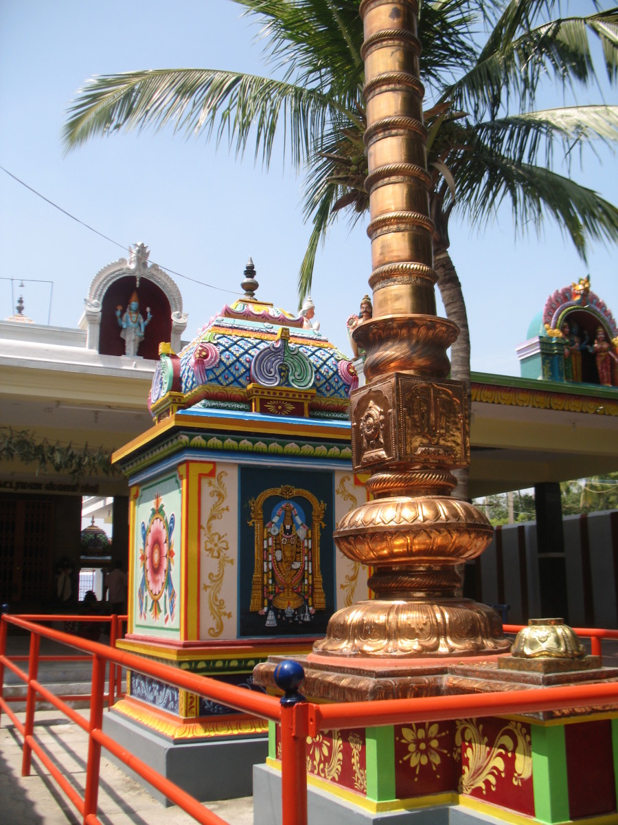 THIS STRUCTURE KNOWN AS GARUDAGAMBA WILL MARK THE MAIN ENTRANCE TO THE TEMPLE.