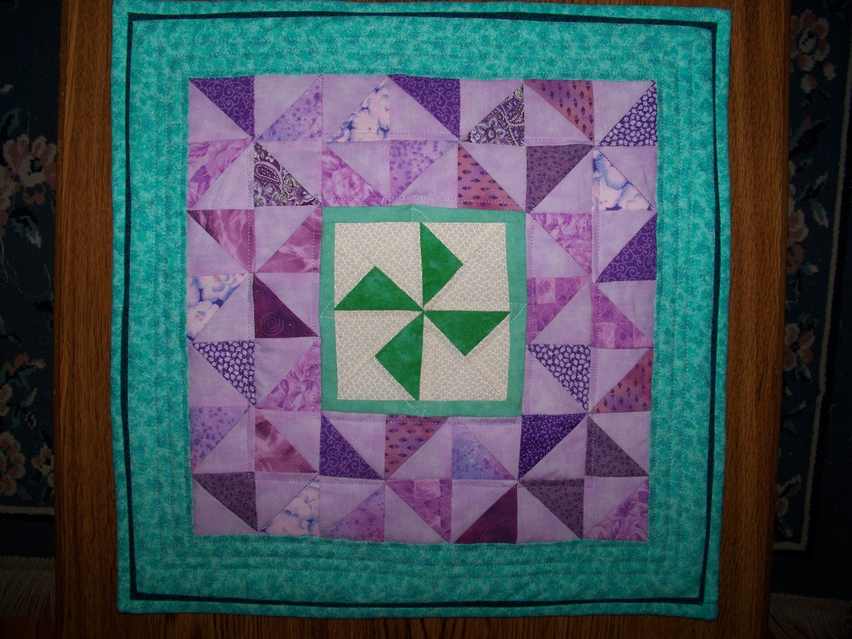 A blue flange added to the binding adds some zing to this pinwheel quilt.