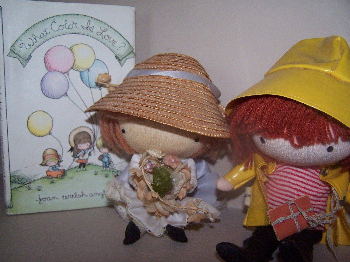 "Joan Walsh Anglund book, ""What Color is Love?"" pictured with two Pocket Dolls."