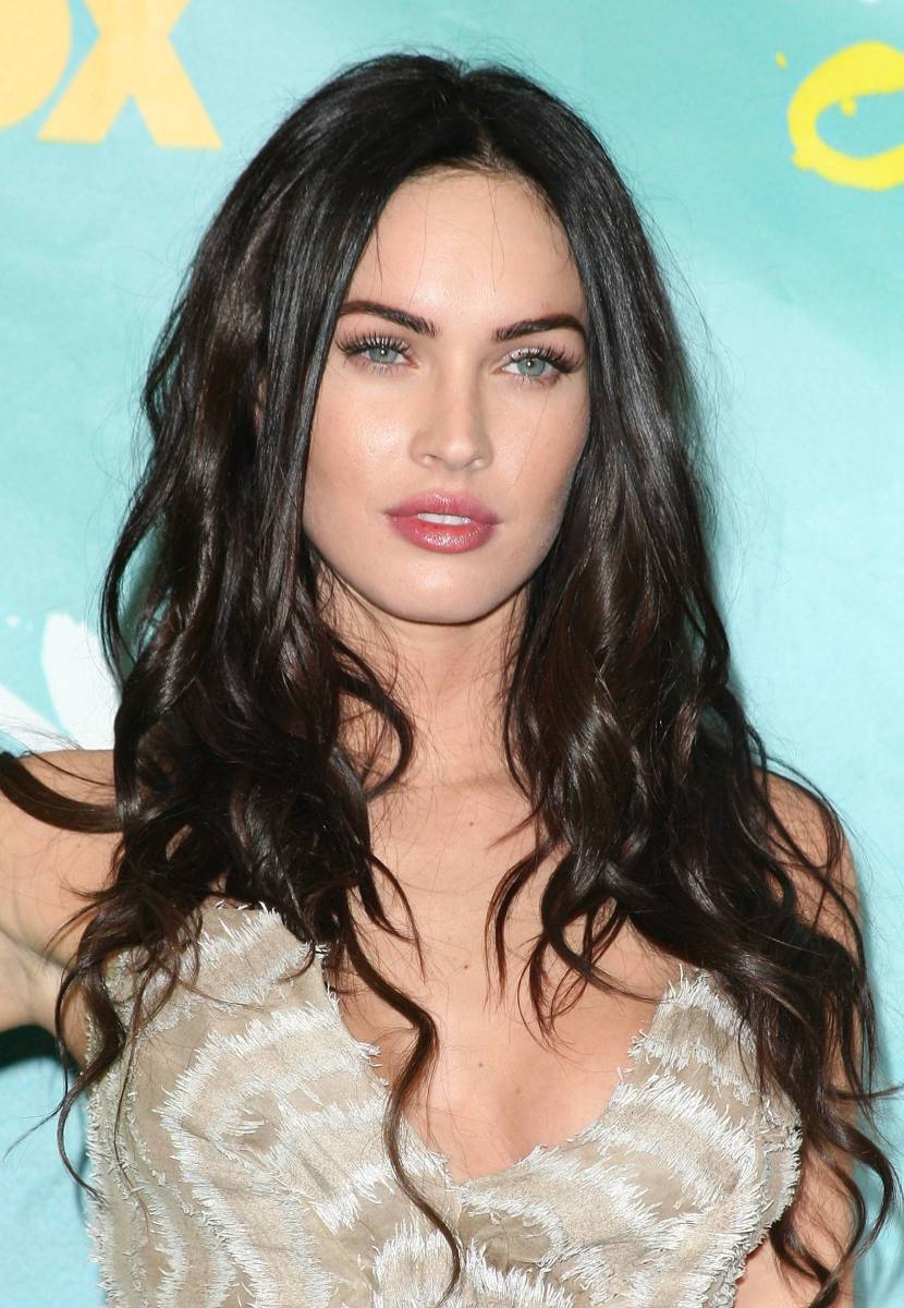 Megan Fox's long hair is extremely flattering for a square face.