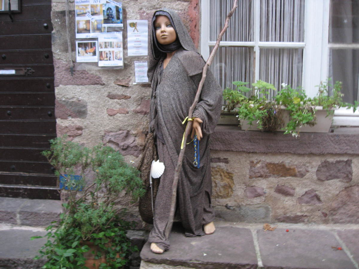 This is a statue of a young woman pilgrim from hundreds of years ago