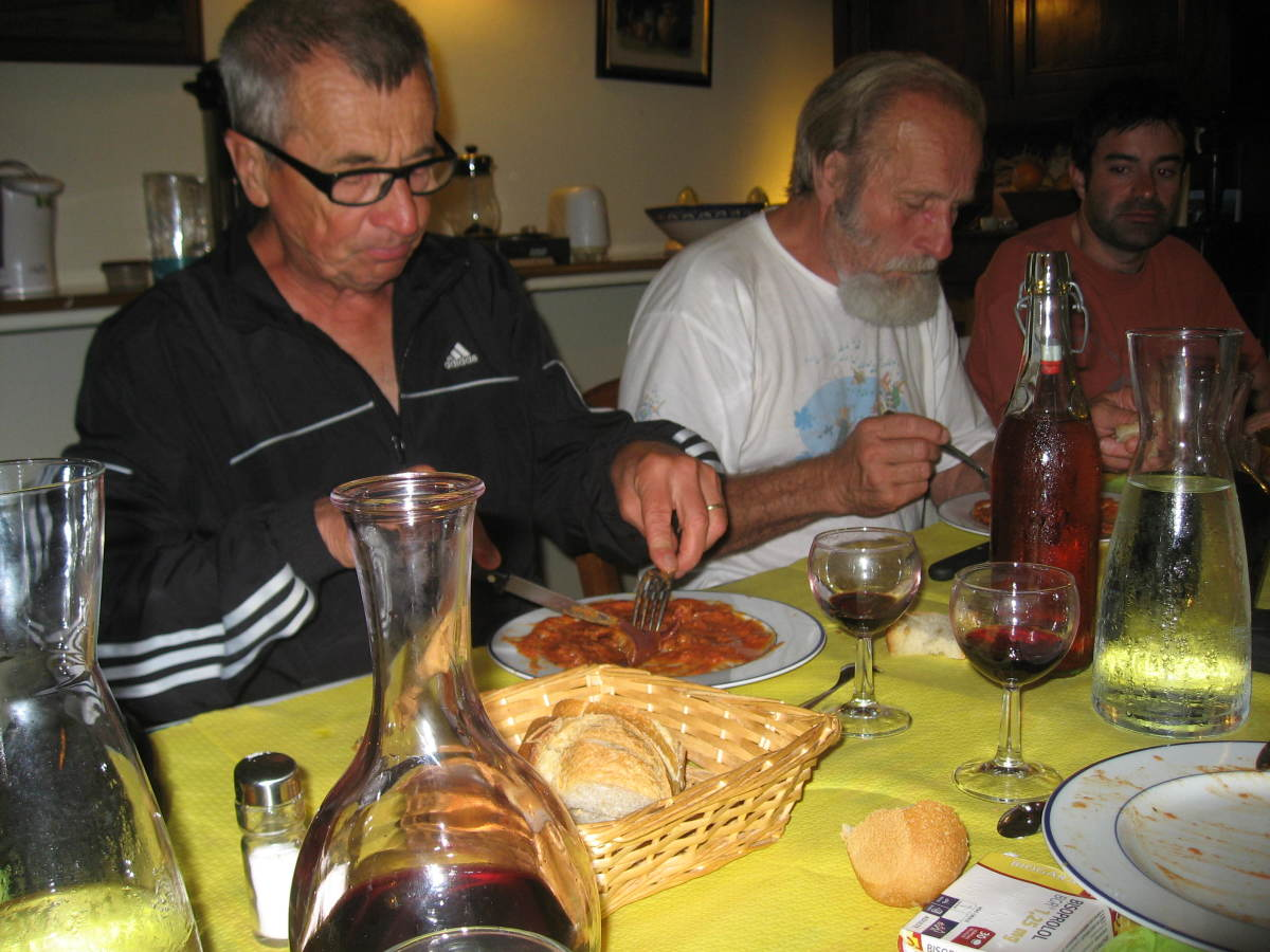 Some french men tuck into dinner.