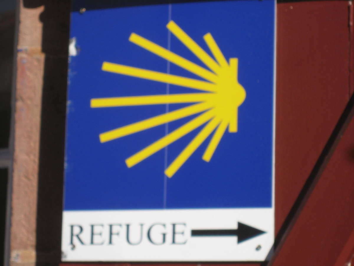 This is the sign of the Camino, shell ,often yellow on a blue background. If you follow it you will not get lost.
