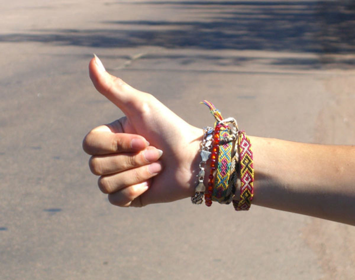 Learn this hitchhiker gesture so that you can afford to learn Spanish!