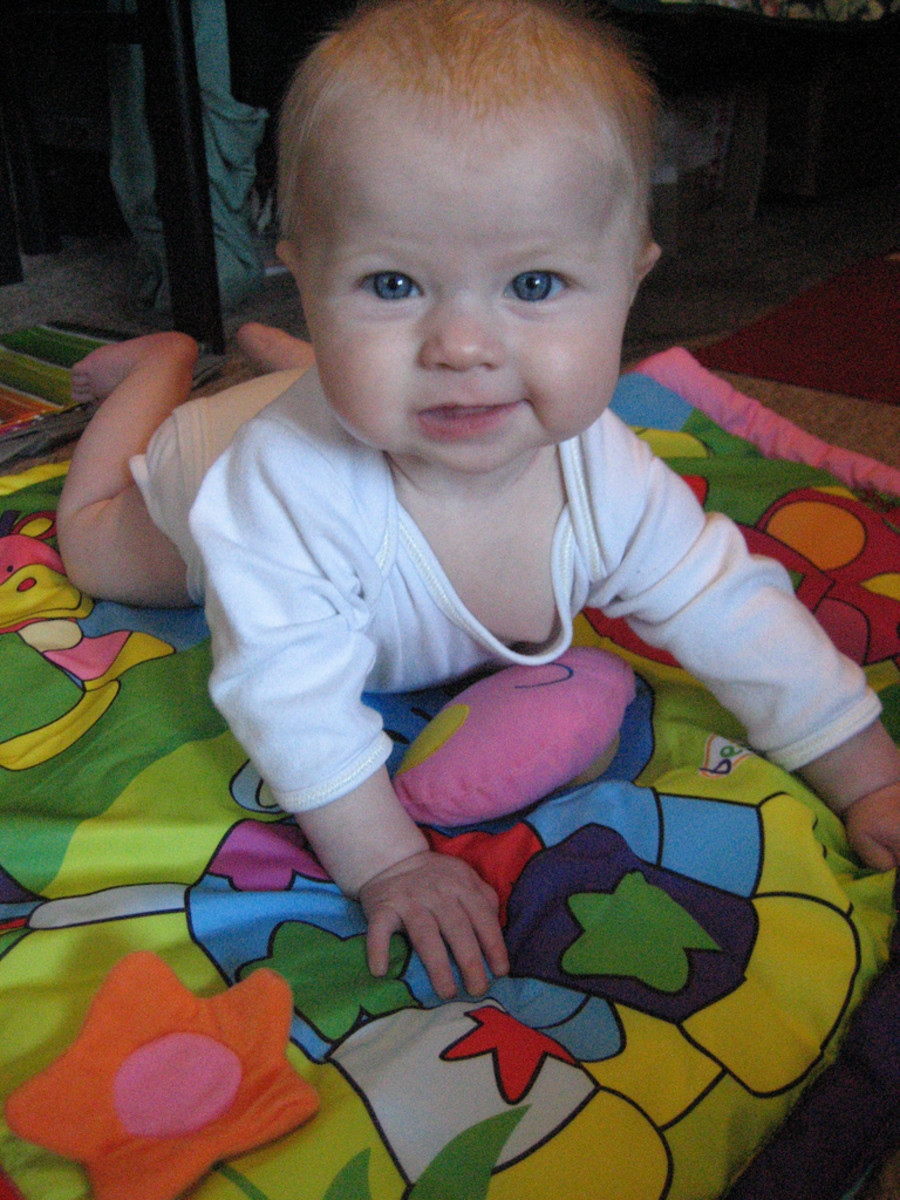 At about 6-10 months, baby is starting to learn to crawl.