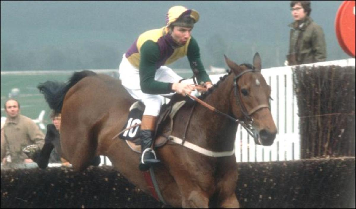 John goes over a fence at the height of his horse racing career