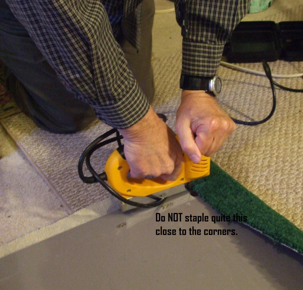 A staple gun beats the old-fashioned carpet tack and hammer system.