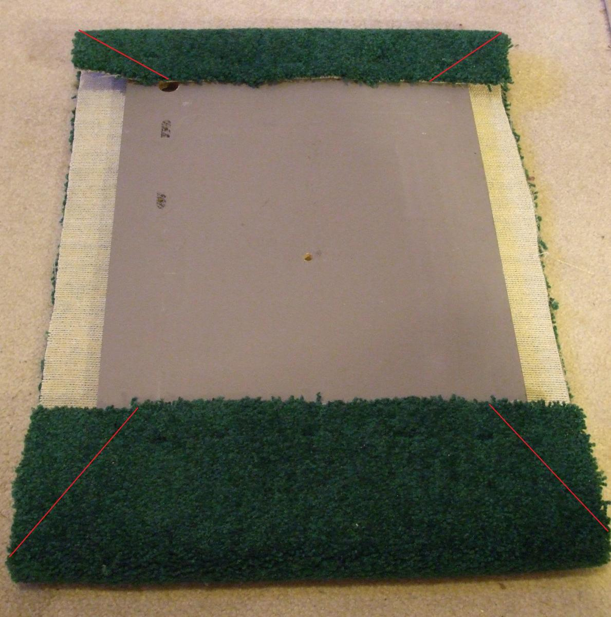 In this photo, the side carpet is much too narrow.  It was hard to fold it up and over the board and have enough to staple into the board.