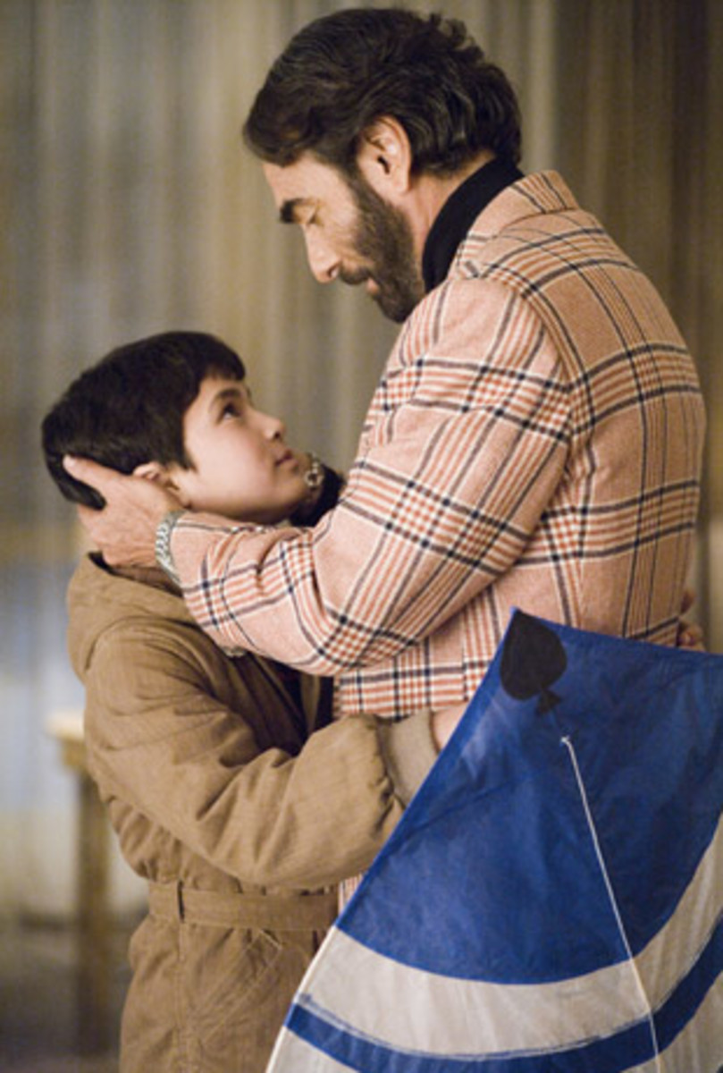 the kite runner relationship between amir and baba
