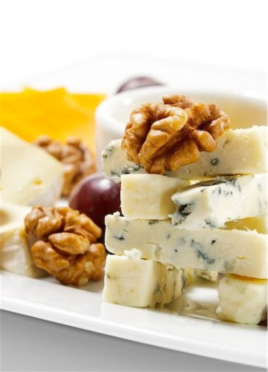 Comes from the unskimmed milk of an Italian cow. Gorgonzola is the name of the milk from the cow. The milk is named after a village that was once outside the city of Milan.