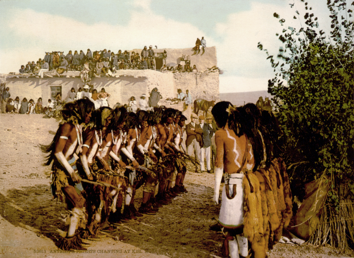 Hopi men performing snake dance during a celebration.
