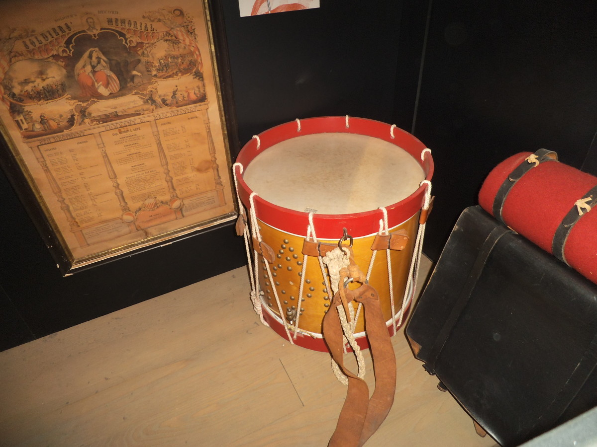 The interest in the war led to children being given toys related to that. Of course, a young boy would want to play games that reminded him of his father away in the army. The photo shows a real drum but a child might have a smaller tin drum.