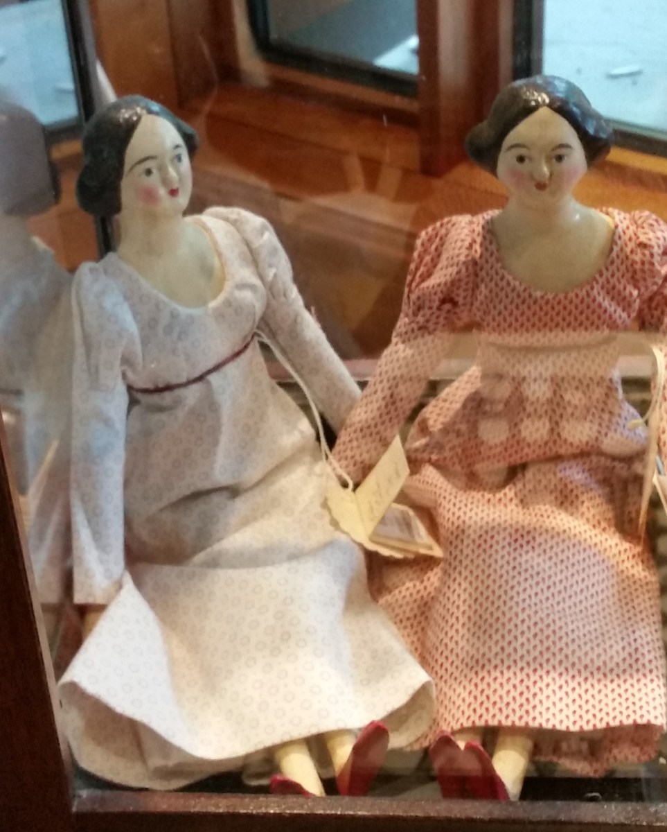 Children in well-to-do households might have a china head doll like these.