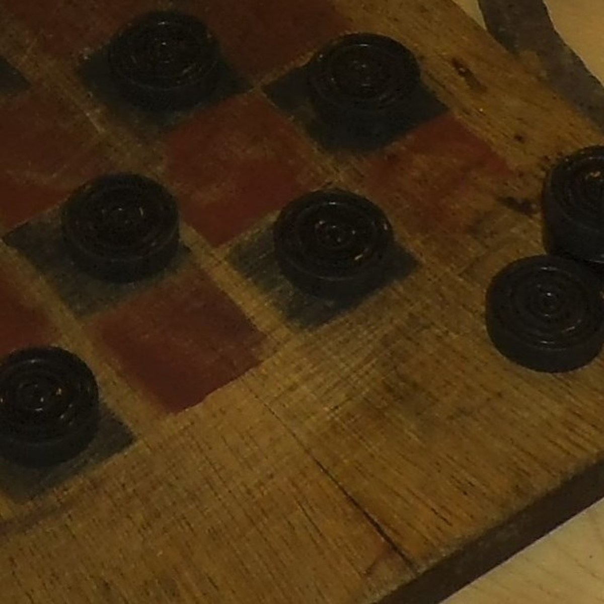 These were simple to make with a square board and some red and black paint. Cut slices from a slender tree branch to make the checker pieces.