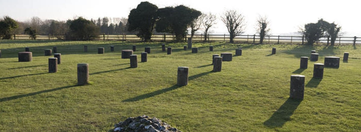 Woodhenge: a Neolithic monument, dating from about 2300 BC, with concrete markers replacing six concentric rings of timber posts, once possibly supporting a ring-shaped building.