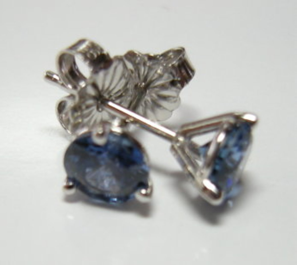 These Yogo Sapphires are set in Platinum post and clutch 'martini' style earrings. The wearer is sensitive to white gold.