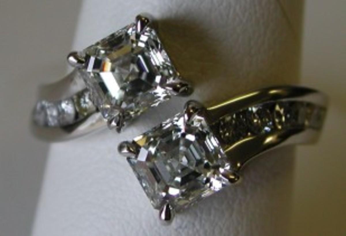 A platinum ring with two one-carat Asscher cut diamonds.