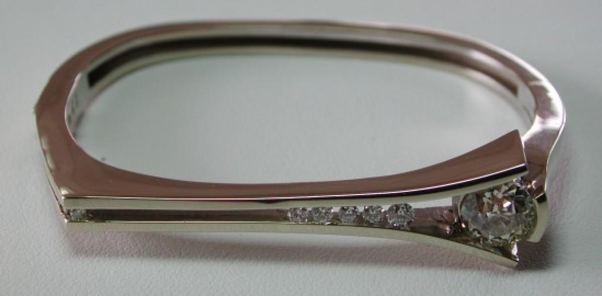 A white gold bracelet by designer John Atencio