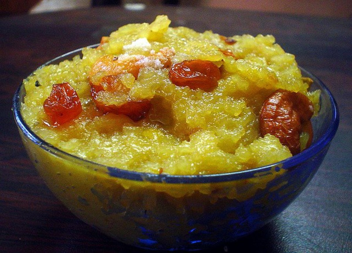 Sakkarai pongal, Indian sweet that is made of newly harvested rice, jaggery, ghee, raisin and cashew nuts, is offered to sun god.