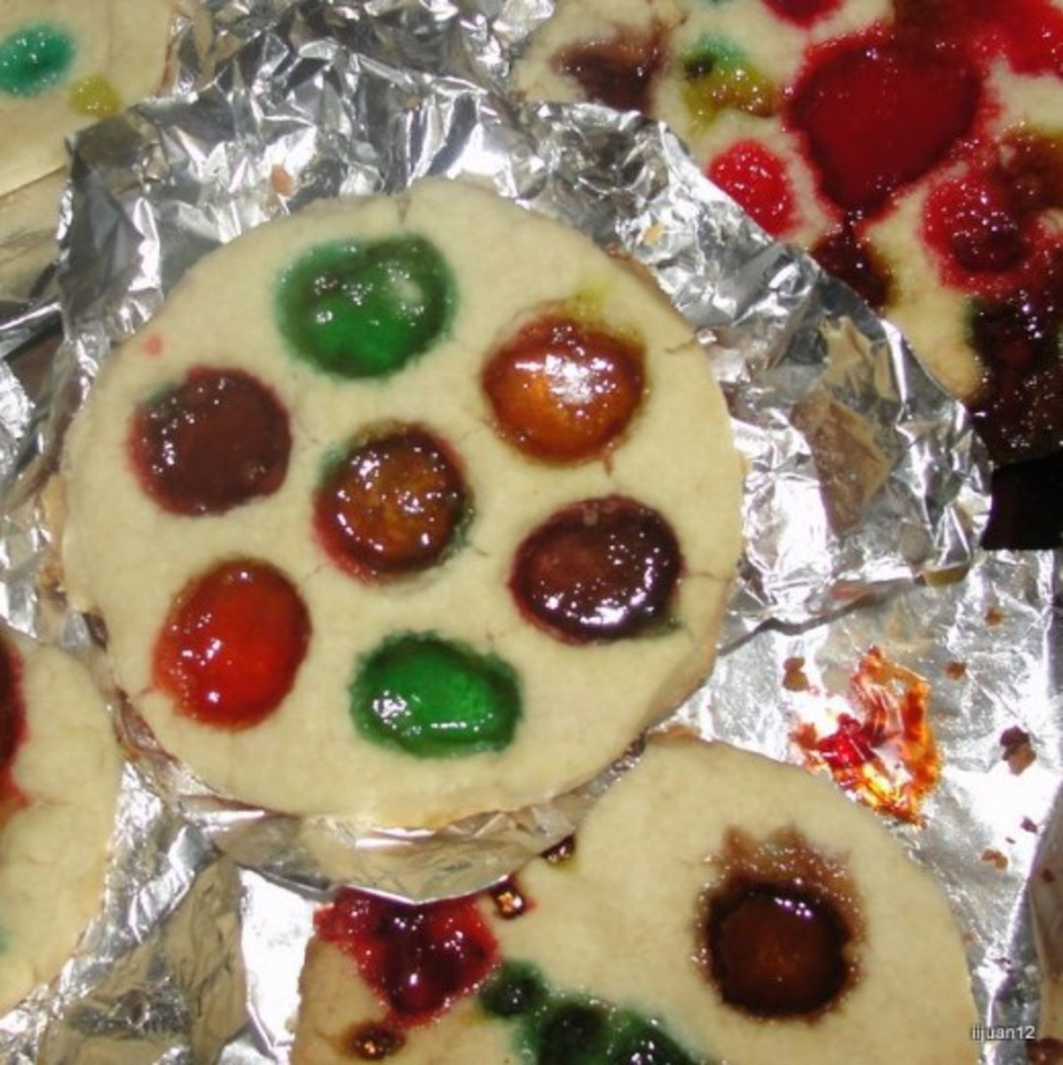 Stained Glass Window Cookies made using sugar cookie dough and crushed Jolly Rancher candy