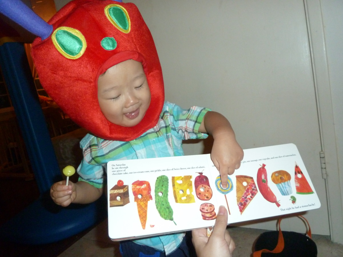 My son's Halloween costume and the foods the caterpillar eats to fatten himself up.
