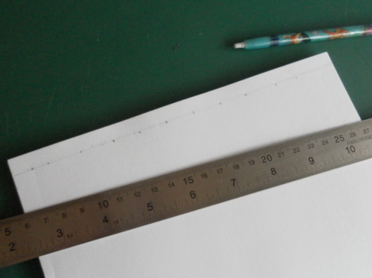 Make markings near the edge of the spine for drilling the holes.