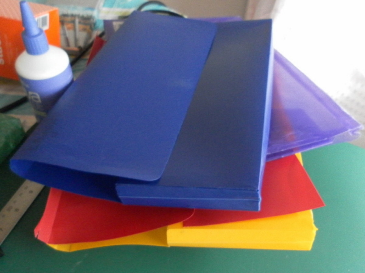 Plastic folders to be recycled into book covers.
