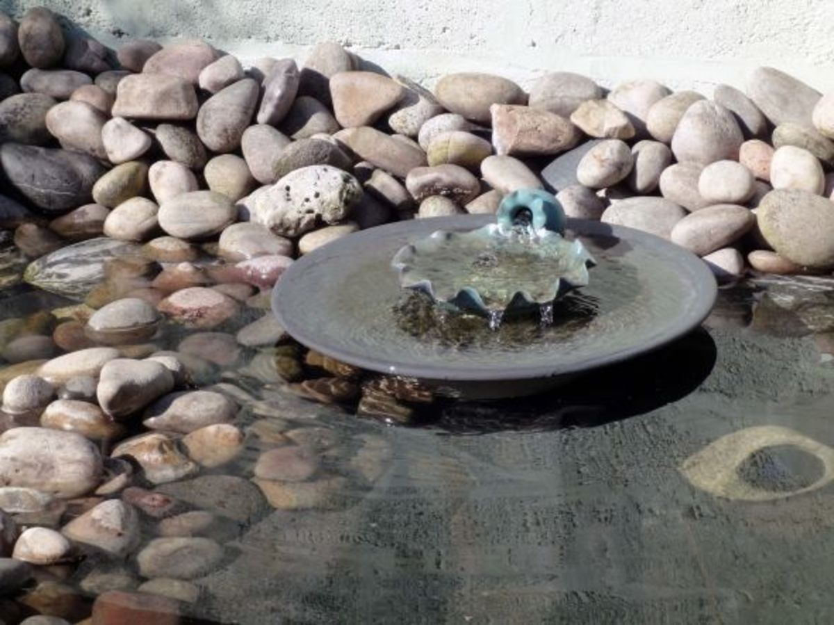 Home made water feature in wildlife pond
