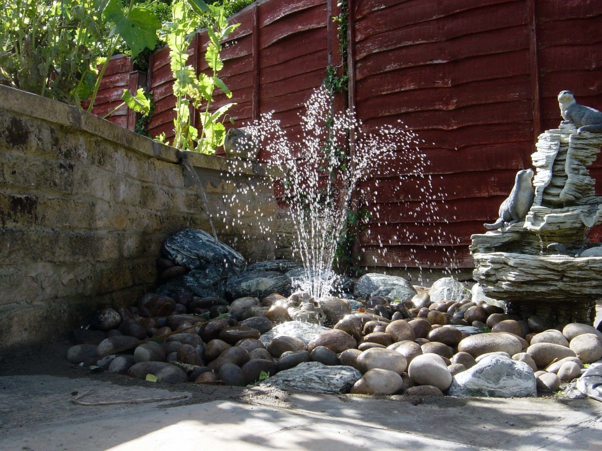Fountain over pebbles