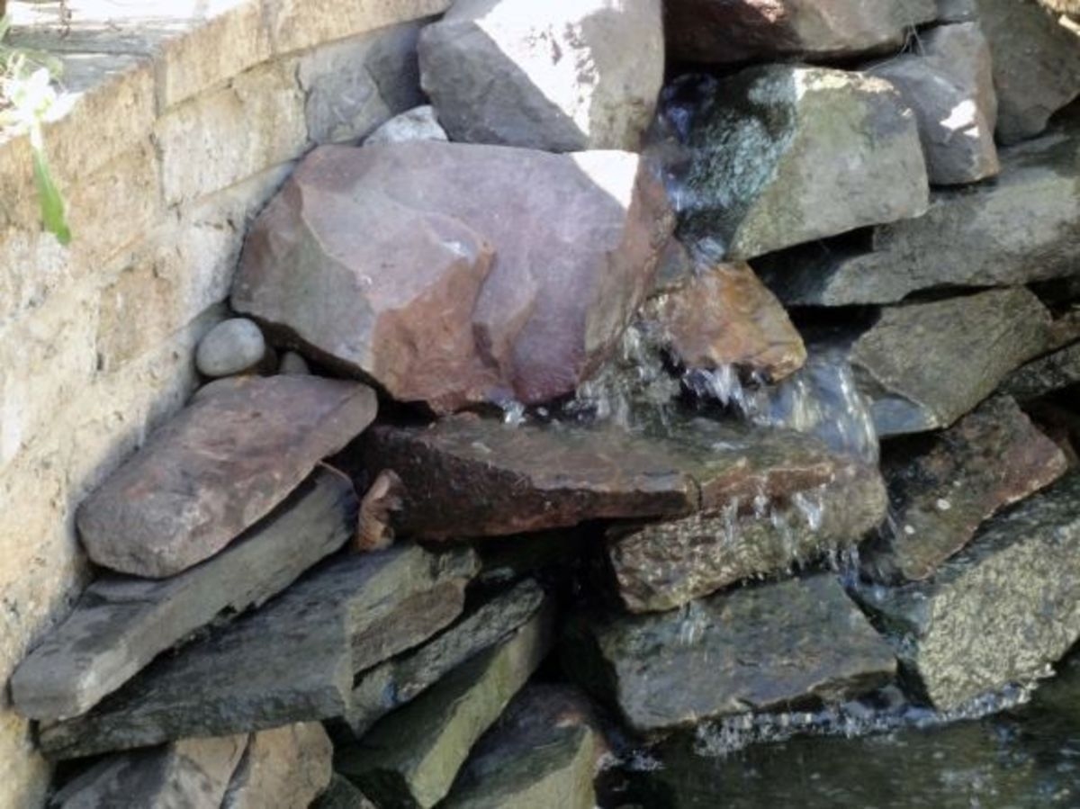 Natural rocks water feature in wildlife pond