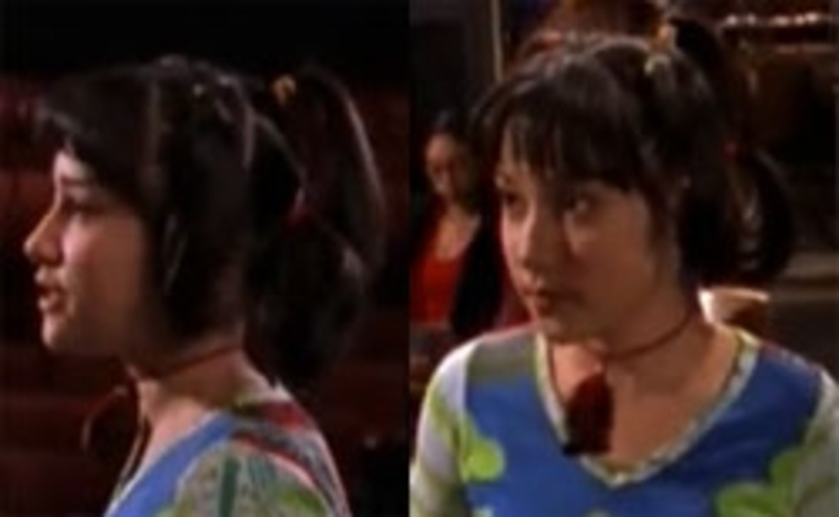 "This is what I like to call Miranda's ""spider hairdo"" as she makes mini ponytails in several different places."